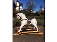 Rocking horse on wooden stand