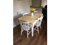 Solid pine farmhouse table and four chairs painted vintage ivory