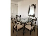 Dining table with 4 chairs, coffee table, mirror set.