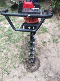 Petrol earth auger