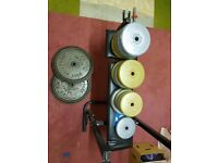 Over 100kg of weights and bench (including 2 x 22.5kg cast iron weights)