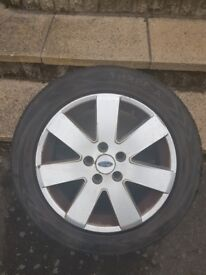 Selling a ford mondeo alloy and wheel. Great tread see photos attached