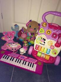 Girls pink Walker and toy bundle