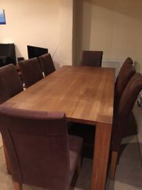 Dinning table and 8 chairs from Furniture Village
