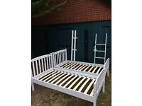 White painted wood bunk beds
