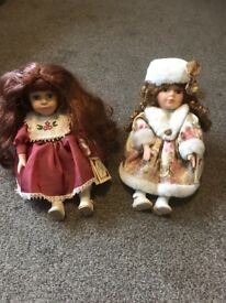 2 collectors choice wind up porcelain dolls