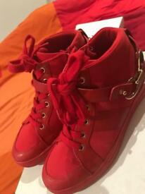 Red high top trainers