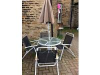 Outdoor table with umbrella and 4 chairs
