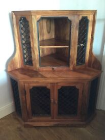 Wood corner cabinet with mesh effect at top and on doors at bottom
