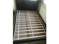 Double leather bed in good condition.
