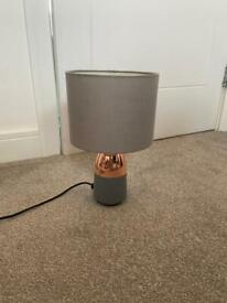 Grey and copper bedside lamps