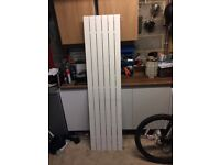 Vertical upright tall radiator in white