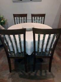 Round extending table - with 4 chairs