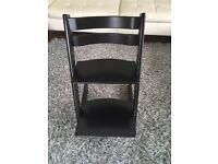 Black Stokke Tripp Trapp chair