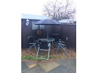 Patio table + 4 chairs set