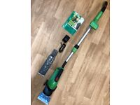 Cordless grass shear and shrub cutter