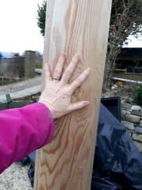 Round wooden pressure treated posts.