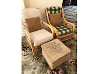 Two cane conservatory / garden chairs with pouffe