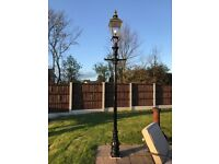 10ft cast lamp post with brass head.