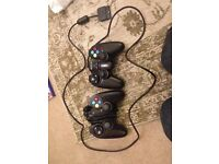 2 x PS2 COMPATABLE CONTROLLERS- PLAYSTION 2 HARDLY USED PICK UP FROM WYMONDHAM