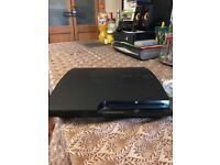 PS3 for sale with 8 free games and two controllers