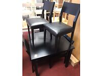 Square Black table and 4 wooden black chairs with soft seat