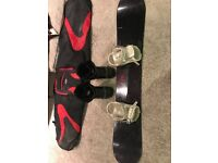 Solomon Ivy 157 Snowboard with bindings and thirtytwo size 9 snowboard boots