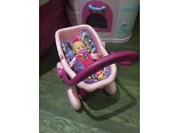 Interactive doll with pram and blanket and cushion