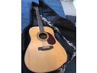 Vintage acoustic guitar, strap and Rockbag for sale