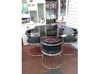 Octagon Tinted Glass table with 4 matching Leather and Chrome chairs. Like New.