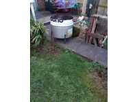 half oil drum garden waste or log burner
