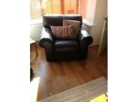 Brown leather three seater sofa and matching armchair