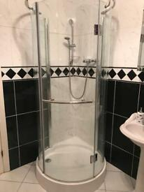 Curved shower screen, tray and shower