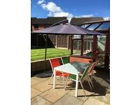 Garden furniture set -parasol, stylish table, coloured chairs and weights included-