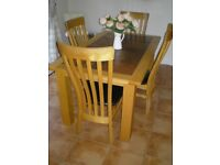 oak dinning table with 4 chairs