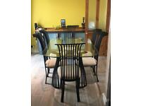 Wrought Iron glass table and 6 chairs. Used condition.