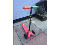 Micro Scooter - runs well and well used - small, three wheel, pink base, green and orange handles