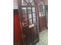 Exterior hardwood door with metal plating fitted to one side