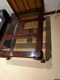 Dark wood and glass panels coffee table