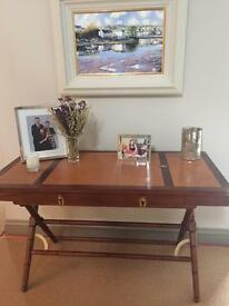 Teak colour table with 3 leather squares on top with brass finish