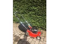 Self propelled petrol lawnmower electric start
