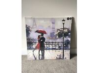 Canvas print of couple in Paris. Brand new in packaging - never been hung.