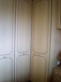 Four wardrobe doors, Two bedside drawer units, one triple dressing table mirror limed ash effect