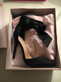 Black stilettos , true ladies eight , surprisingly comfortable, if you can wear heels