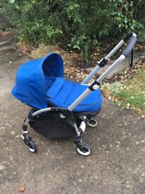 Bugaboo Bee Plus with blue sun canopy, cocoon, foot muff and rain cover
