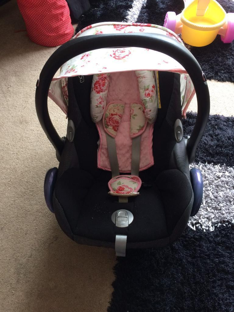 Maxi cosi baby car seat with rose pattern cover