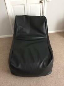 Leather look bean bag. If anyone interested would like to sell ASAP