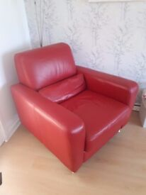 Beautiful and immaculate red leather chair and matching red leather footstool