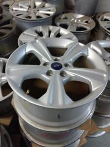 235 55 17 tires on 2016 OEM Ford Escape / Fusion alloy rims 5 x 108  $1100 set of 4 // Set of alloy rims only -- $500