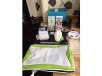 wii and wii fit with games and one control one nun chuck see description